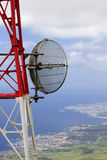 Telecommunication. A telecommunication tower with the sea on the background (Azores Royalty Free Stock Photo