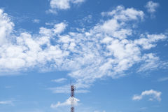 Telecommunication Antenna on blue sky and cloud background. Royalty Free Stock Photos