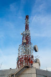 Telecommunication Antenna. With microwave link over a blue sky Royalty Free Stock Image