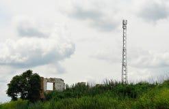 Telecommunication antenna tower among the ruins Royalty Free Stock Photo