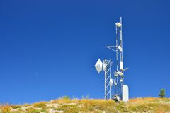 Telecommunication antennas. On top of a hill royalty free stock photos