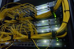 Telecommunication Broadband Fiber Optical Cables. Datacenter rack. Technology concept. Telecommunication Broadband Fiber Optical Cables. Datacenter rack stock photo