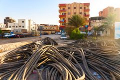 Telecommunication cables before laying in the ground on residential area Stock Photography