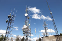Telecommunication & cell towers technology. Royalty Free Stock Photos