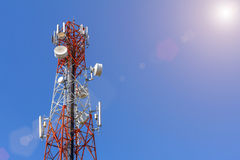 Telecommunication, Cellular or Radio antenna tower in blue sky. Royalty Free Stock Image