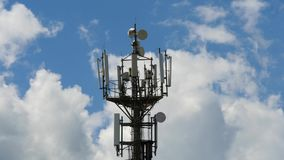 Telecommunication cellular tower against blue sky Royalty Free Stock Images