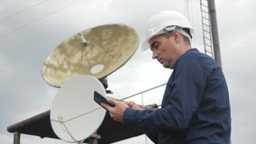 Telecommunication Internet connection concept industry production station concept. TV station worker man engineer stock video