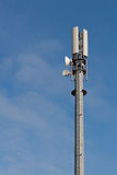 Telecommunication Mast. With microwave link antennas over a blue sky Royalty Free Stock Image