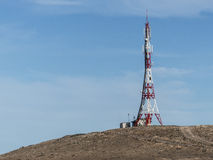 Telecommunication mast on mountain top with mobile phone net dev Stock Images