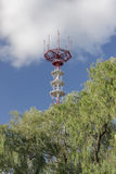 Telecommunication mast over a blue sky. Royalty Free Stock Images