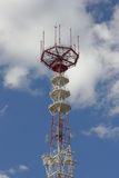 Telecommunication mast over a blue sky. Stock Photos