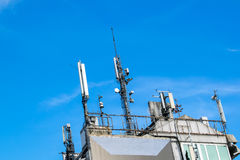 Telecommunication mast TV antennas wireless technology with blue sky Royalty Free Stock Photography