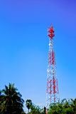 Telecommunication post. In green forest on the blue sky royalty free stock photos