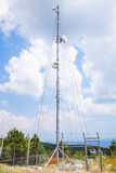 Telecommunication radio tower with devices Royalty Free Stock Image