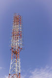 Telecommunication, AM radio and TV broadcast tower. Telecommunication tower , AM radio and TV broadcast tower against blue sky background, Thailand Stock Image