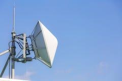 Telecommunication satellite and radio transmitter Royalty Free Stock Photo