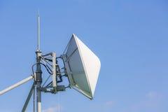 Telecommunication satellite and radio transmitter Stock Images