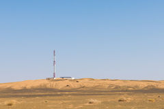 The telecommunication station in the desert with solar cell Royalty Free Stock Photo