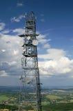 Telecommunication tower. On landscape background Royalty Free Stock Photo