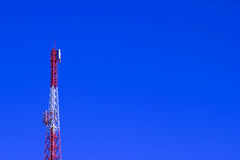 Telecommunication tower. And blue sky background Royalty Free Stock Photos