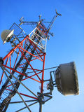 Telecommunication tower. In the blue sky Royalty Free Stock Photo