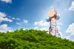 Telecommunication tower above treetop Stock Photography