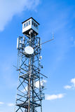 Telecommunication tower against the blue sky Royalty Free Stock Photos