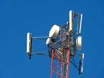 Cell antenna, transmitter. Telecom TV radio mobile tower against blue sky Stock Images