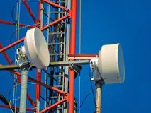 Cell antenna, transmitter. Telecom TV radio mobile tower against blue sky Stock Image