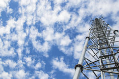 Telecommunication tower and antenna against the sky Royalty Free Stock Photography