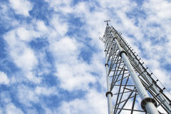 Telecommunication tower and antenna against the sky Royalty Free Stock Photos