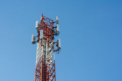 Telecommunication tower antenna. Telecommunication antenna in blue sky Stock Image