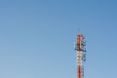 Telecommunication tower antenna. Telecommunication antenna in blue sky Stock Photography