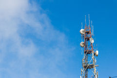 Telecommunication tower antenna with blue sky and cloud background Stock Photo