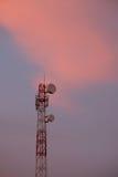 Telecommunication tower antenna at sunset Stock Photo