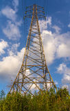 Telecommunication tower with antennas against blue sky Stock Image