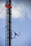 Telecommunication tower with antennas on blue sky. Royalty Free Stock Photography