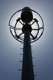 Telecommunication tower on the backlight  Stock Photos