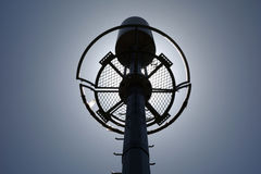 Telecommunication tower on the backlight Stock Image