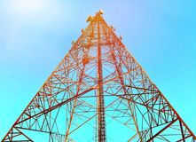 Telecommunication tower in beautiful clear sky. Artificial light was added on the top left corner stock image