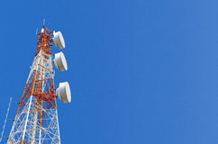 Telecommunication tower on blue sky background Royalty Free Stock Photos