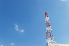 Telecommunication tower on blue sky blank background Royalty Free Stock Photos