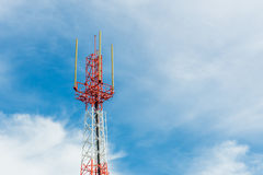 Telecommunication tower on blue sky and cloud background Stock Photography