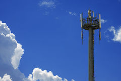 Telecommunication Tower on Blue Sky Stock Photo