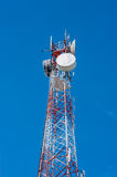 Telecommunication tower on blue sky Royalty Free Stock Image