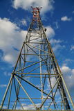Telecommunication tower with blue summer sky Royalty Free Stock Images