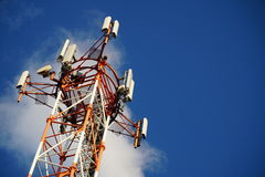 Telecommunication tower with blue summer sky Stock Photo