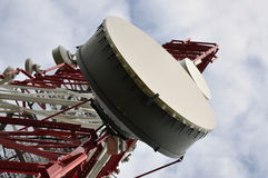 Telecommunication tower with cell phone antenna Royalty Free Stock Photos