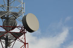 Telecommunication tower with cell phone antenna system Royalty Free Stock Photos