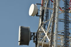 Telecommunication tower with cell phone antenna system Stock Photos